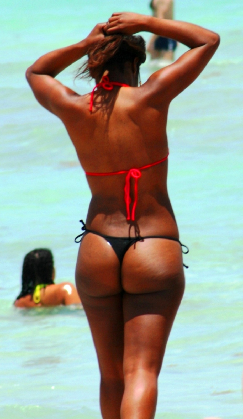 So are thongs finally the standard beach attire for women?