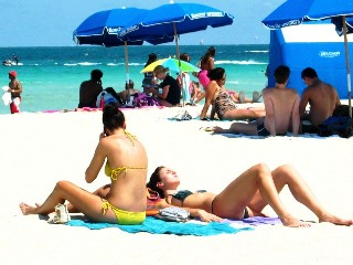 Two Beautiful Beach Girls Getting 