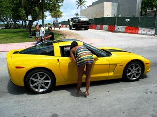 Sweetie Admires Yellow Corvette - © 2009 Jimmy Rocker Photography
